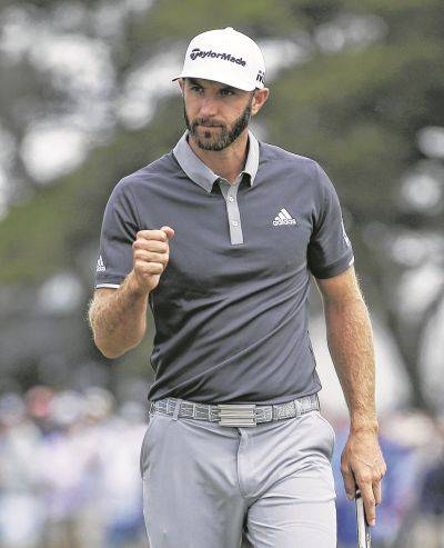 Dustin Johnson reacts after making a birdie putt on the fourth green during Friday's second round of the U.S. Open in Southampton, N.Y. AP photo