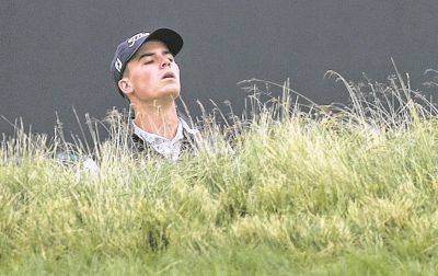 Michael Miller checks his line to the green during a U.S. Open practice round Wednesday at Shinnecock Hills in Southampton, N.Y. AP photo