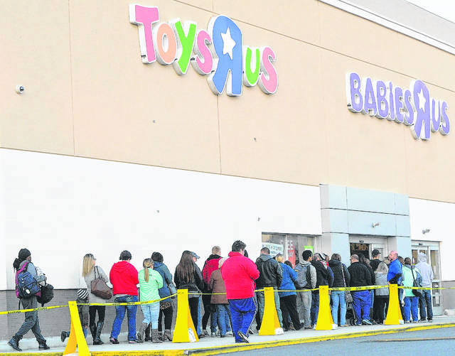 "Customers line up outside Toys ""R"" Us in Lima last Thanksgiving to get holiday shopping deals. The store is set to close June 30."