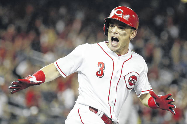 Cincinnati's Scooter Gennett) celebrates his two-run homer in the ninth inning of Tuesday night's Major League Baseball All-star Game in Washington. Teams may have difficulty getting the Reds to trade the hometown favorite who can't become a free agent until 2020.