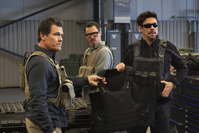 """This image released by Sony Pictures shows Josh Brolin, from left, Jeffrey Donovan and Benicio Del Toro in """"Sicario: Day of the Soldado."""" (Richard Foreman, Jr./Sony Pictures via AP)"""