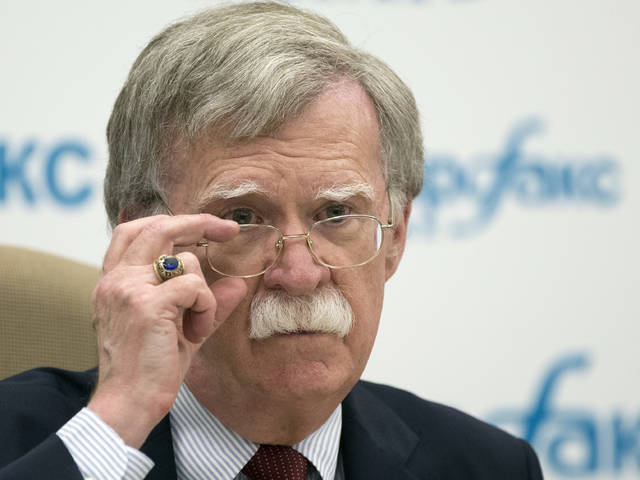 FILE - In this file photo taken Wednesday, U.S. National security adviser John Bolton listens to question as speaks to the media after his talks with Russian President Vladimir Putin in Moscow, Russia. Bolton said Sunday the U.S. has a plan that would lead to the dismantling of North Korea's nuclear weapons and ballistic missile programs in a year.
