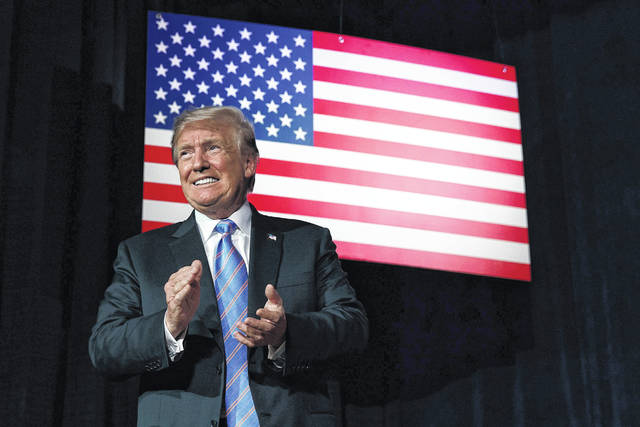 """President Donald Trump arrives to speak to a """"Salute to Service"""" dinner Tuesday in White Sulphur Springs, W.Va. Trump has found a receptive audience for his campaign-style rallies on Fox News Channel. The network carried the president speaking live to supporters four times in the past few weeks, and planned to do so again on Thursday. By contrast, CNN and MSNBC don't carry the speeches live."""