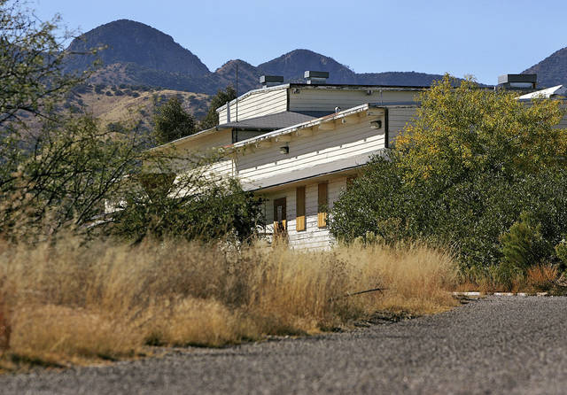 FILE - In this Thursday, Nov. 11, 2004 file photo, the Mountain View Officers' Club, built in 1942, is shown, at Ft. Huachuca, Ariz. The structure is the last of over 14,000 wooden structures built at the fort to house, train,and care for black soldiers preparing for World War II. Once slated for destruction, efforts are now underway to restore the building to its WWII condition. (AP Photo/Matt York, File)