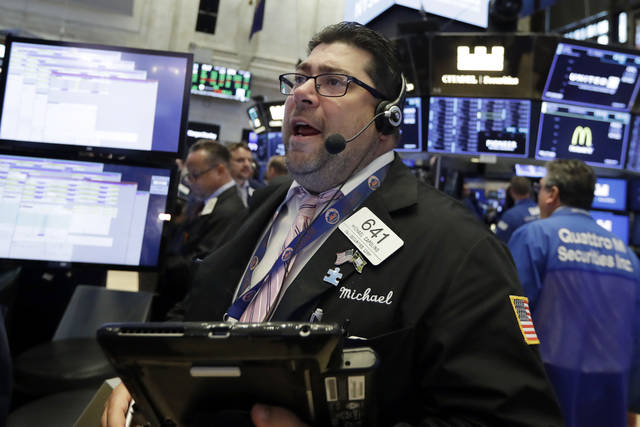Trader Michael Capolino works on the floor of the New York Stock Exchange, Tuesday, July 10, 2018. Energy and industrial companies are leading stocks higher in early trading on Wall Street following three straight days of gains for the market. (AP Photo/Richard Drew)