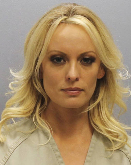 This photo provided by the Franklin County Sheriff's Office on Thursday, July 12, 2018, shows porn actress Stormy Daniels.  Daniels was arrested at a Columbus, Ohio strip club and is accused of letting patrons touch her in violation of a state law, her attorney said early Thursday. (Franklin County Sheriff's Office via AP)