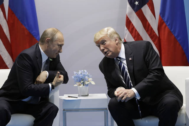 """FILE - In this July 7, 2017, file photo, President Donald Trump meets with Russian President Vladimir Putin at the G20 Summit in Hamburg. Trump seems of two minds about nuclear weapons. He has mused about their elimination. But he also has called for a U.S. buildup and bragged about his nuclear """"button."""" How these seemingly competing instincts will play out in his Helsinki talks with Putin on Monday could profoundly affect the direction of U.S. defense policy."""