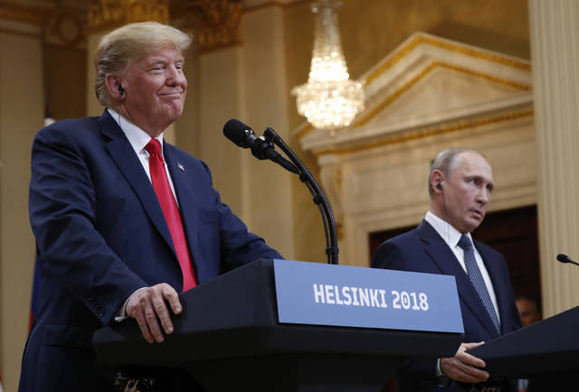 U.S. President Donald Trump, left, smiles beside Russian President Vladimir Putin during a press conference after their meeting at the Presidential Palace in Helsinki, Finland, Monday.