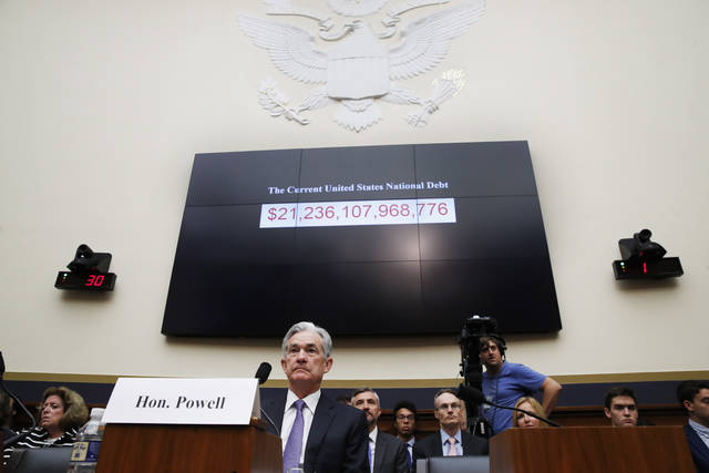 Federal Reserve Board Chair Jerome Powell attends a House Committee on Financial Services hearing, Wednesday, July 18, 2018, on Capitol Hill in Washington. (AP Photo/Jacquelyn Martin)