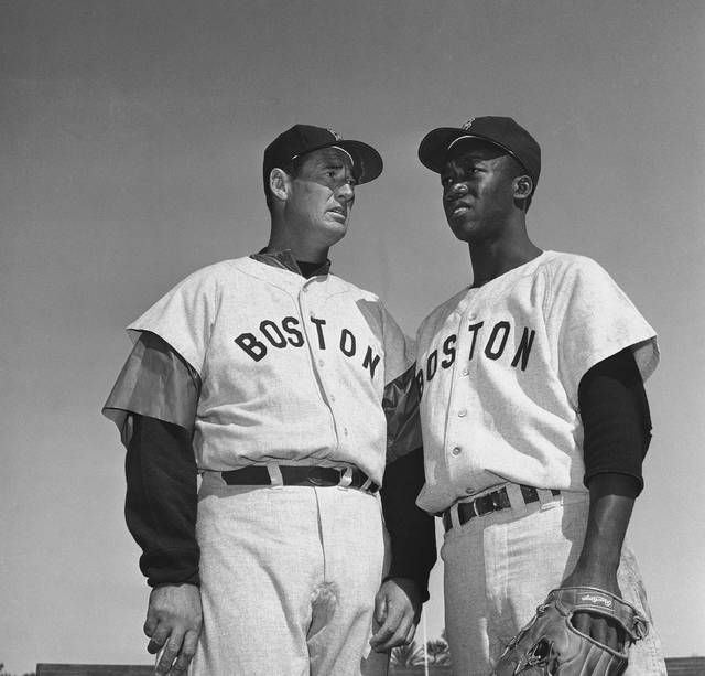 "In this March 4, 1959, file photo, Ted Williams, long-time Red Sox batting ace, chats with E.J. ""Pumpsie"" Green at the Boston training camp in Scottsdale, Ariz. A new film explores the life of baseball legend Williams, who struggled with his Mexican-American heritage and his volatile relationship with his family and the press."