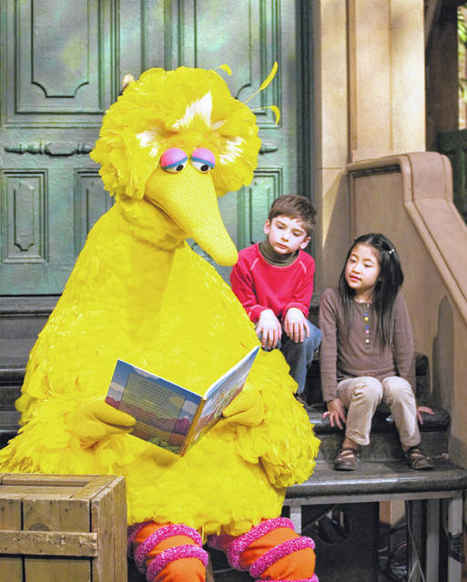 Big Bird reads to Connor Scott and Tiffany Jiao during a taping of Sesame Street in New York on April 10, 2008. The Sesame Street company is taking its beloved, critically-acclaimed brand of educational television into the highly profitable world of classroom curriculum.