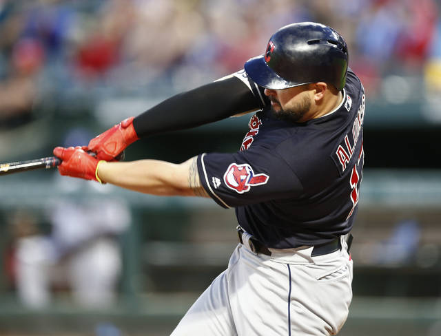 Cleveland Indians' Yonder Alonso follows through on his two-run home run against the Texas Rangers during the fifth inning of a baseball game Saturday, July 21, 2018, in Arlington, Texas. (AP Photo/Jim Cowsert)