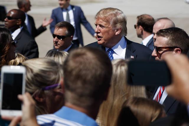 President Donald Trump greets supporters after arriving at the Kansas City International Airport to attend the national convention of the Veterans of Foreign Wars, Tuesday in Kansas City, Mo.