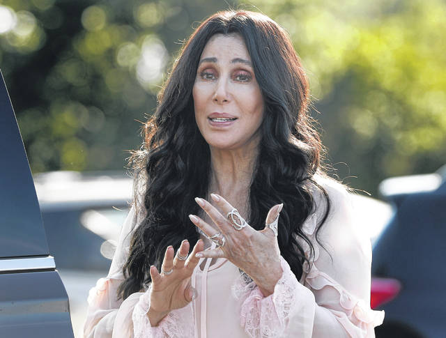 Singer and actress Cher stops to talk to media as she leaves a fundraiser Aug. 21, 2016, at the Pilgrim Monument and Provincetown Museum in Provincetown, Mass. Cher, composer Phillip Glass, country music star Reba McEntire and jazz legend Wayne Shorter have been announced as this year's recipients of the Kennedy Center Honors awards.