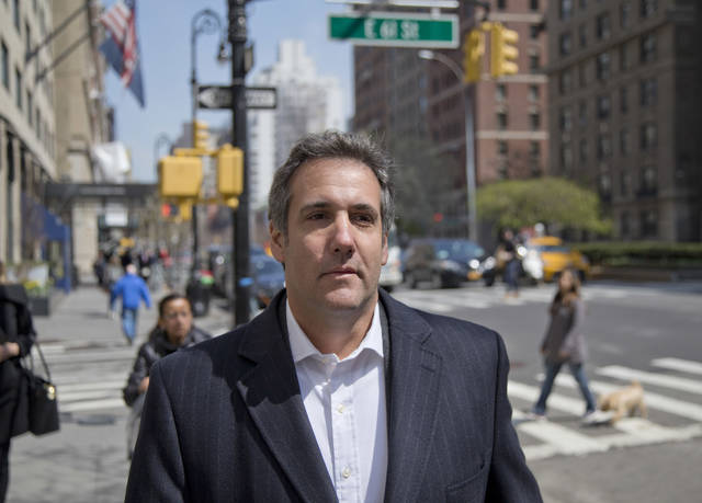 FILE - In this April 11, 2018, file photo, attorney Michael Cohen walks down the sidewalk in New York. Two months before the 2016 election, Donald Trump and his former lawyer Cohen discussed plans to pay for a former Playboy model's story of alleged an affair, according to a secretly recorded tape of the conversation released amid an escalating feud between the president and his longtime personal attorney.