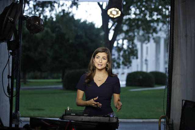 """CNN White House correspondent Kaitlan Collins talks during a live shot in front of the White House on Wednesday in Washington. Collins says the White House denied her access to President Donald Trump's Rose Garden statement with the European Union Commission president because officials found her earlier questions """"inappropriate."""""""