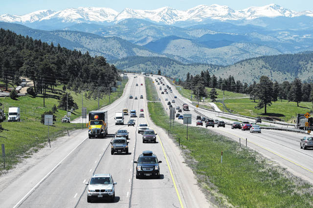 Motorists guide their vehicles down Interstate 70 near Evergreen, Colo., in May. Drivers expect insurance companies to offer digital experiences on par with the likes of Amazon, Uber and Netflix. Insurers are far from meeting those expectations, but they're stepping up their game in the battle for customers.