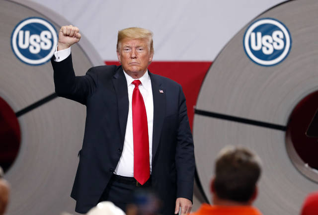 In this July 26, 2018, photo, President Donald Trump acknowledges the audience after speaking at the United States Steel Granite City Works plant in Granite City, Ill. Trump's trade policies are turning long-established Republican orthodoxy on its head. There are tariff fights, and there's now $12 billion in farm aid that represents the type of government intervention GOP voters railed against a decade ago.