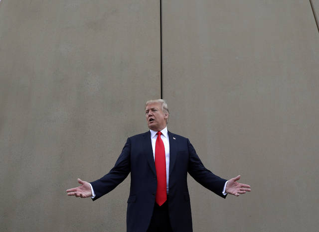 FILE - In this March 13, 2018, file photo, President Donald Trump speaks during a tour as he reviews border wall prototypes in San Diego. Trump said Sunday that he would consider shutting down the government if Democrats refuse to vote for his immigration proposals, including building a wall along the U.S.-Mexico border.