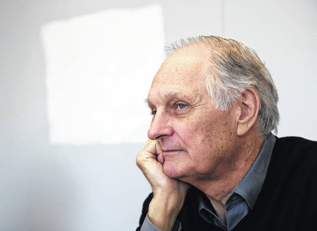 "Alan Alda listens during an interview in April 2013 at Stony Brook University, on New York's Long Island. Alda says he has Parkinson's disease. Appearing Tuesday on ""CBS This Morning,"" the former ""M*A*S*H"" star said he was diagnosed with the neurodegenerative disorder three and a half years ago."