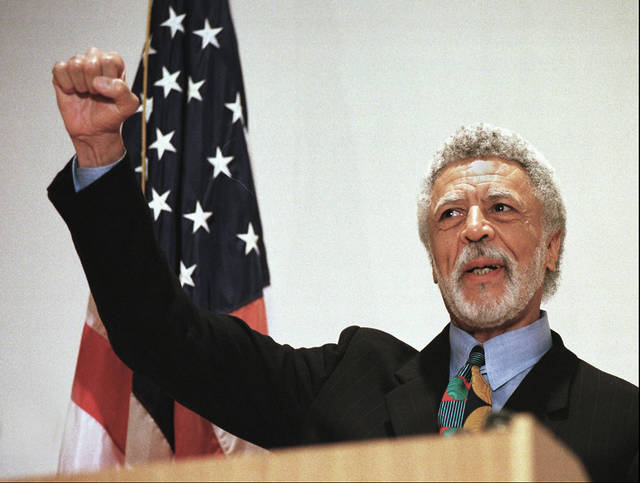 FILE - In this Nov. 17, 1997 file photo Democratic Rep. Ron Dellums raises his fist while announcing his retirement from Congress at a news conference in Oakland, Calif. Dellums, a fiery anti-war activist who championed social justice as Northern California's first black congressman, has died at age 82.