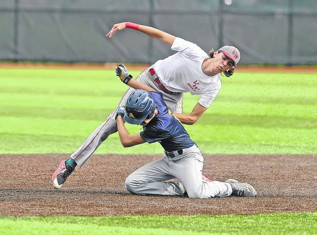 Van Wert's Jaxson Amweg, left, tags out Archbold's Jeron Williams during Monday's ACME State Championship game at Defiance High School.