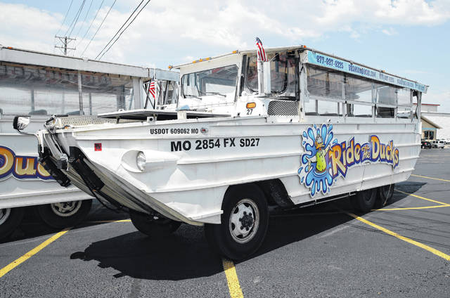 A duck boat sits idle in the parking lot of Ride the Ducks, an amphibious tour operator in Branson, Mo. Friday, July 20, 2018. The amphibious vehicle is similar to one of the company's boats that capsized the day before on Table Rock Lake resulting in 17 deaths.