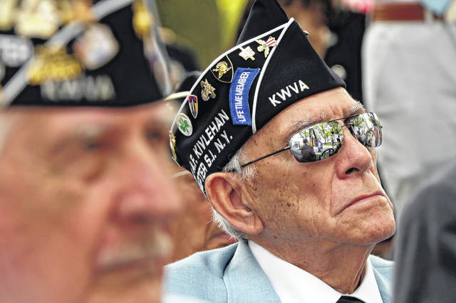 A Korean War veteran listens to former Congressman Charles Rangel at the Korean War memorial at Battery Park in New York, Friday, July 27, 2018. Korean War veterans have something extra to celebrate as they mark the 65th anniversary of the armistice that ended combat.