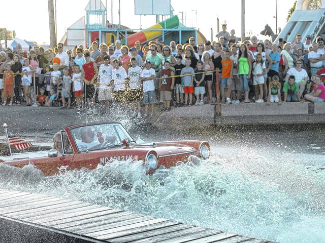An Amphicar splashes into Grand Lake St. Marys during last year's Celina Lake Festival.