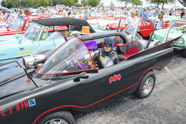 """""""Batman"""" and """"Batgirl"""" posed for pictures in Roger Salee's Batmobile at the Celina Lake Festival."""