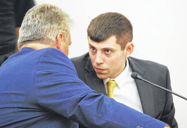 Former Shawnee teacher Kyle Baker converses with his attorney during a sentencing hearing Tuesday in Allen County Common Pleas Court. Baker was sentenced to a total of 54 months in prison for having sexual relations with a 14-year-old student.