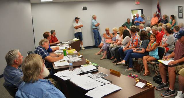 Several Bath Township residents voice opposition to a potential commercial development during a Bath Township Zoning Commission meeting Tuesday. Josh Ellerbrock | The Lima News