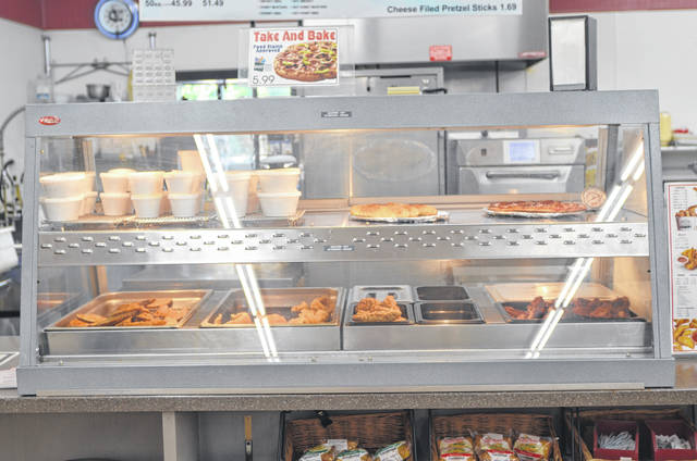 Fried chicken, potato wedges, fried fish, and mac and cheese are just some of the items offered at Meat City Drive-Through, 801 E Kibby St., Lima.