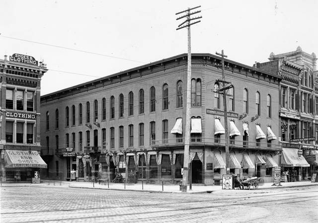 The Collins Block, pictured in 1938. Samuel Collins built this downtown structure in the northwest corner of the Public Square. Note the hitching posts.