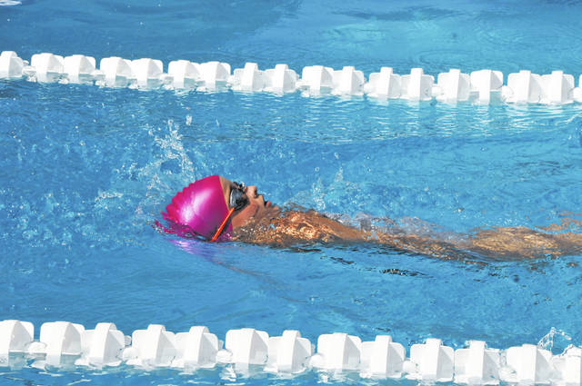 Westside's Vivian Elrod competes in the 50 meter backstroke at the West Ohio Aquatic League championships in Wapakoneta Saturday.