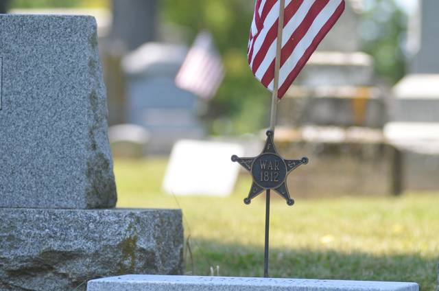 James Coe's grave marker has a rare addition -- a flag and medal showing his participation in the War of 1812.