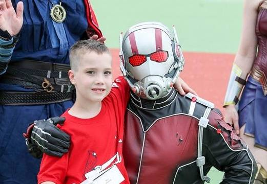 Ant-man poses with an individual during an event held with the Allen County Abilities Baseball League. (Photo provided)