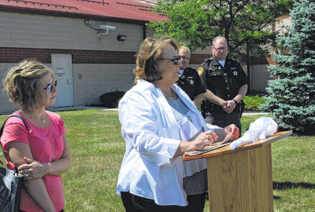 Janice Longsworth thanks those who attended a ceremony for her late husband Thursday in Wapakoneta.