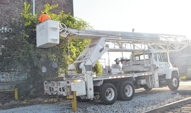 Jeremy S&S Tree Service and Stump Removal employee Andy Williams examines a tree for damage on Elizabeth Street, Lima.