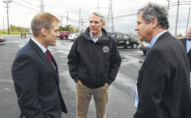 Ohio Sens. Rob Portman, a Republican, and Sherrod Brown, a Democrat, pushed through a $1.08 billion appropriation for the latest version of the Abrams tank. They are shown outside of the tank plant with U.S. Rep. Jim Jordan, a Republican activist. Ohio's congressional delegation pushed through funding for 200 additional tanks that the Pentagon said it would keep in storage, adding to the thousands of decommissioned Abrams tanks lined up side by side outside at the vast Sierra Army Depot in Herlong, Calif. Craig Orosz | The Lima News