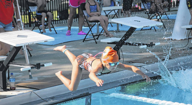 Kenton's Kyndal Gammon dives right in during the 6 and under 25 meter freestyle event at the Western Ohio Aquatic League championships Friday in Wapakoneta. Jose Nogueras | The Lima News