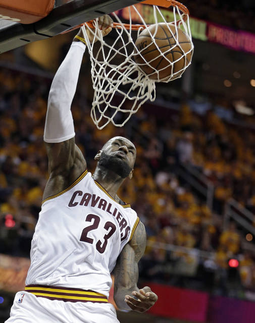 Cleveland Cavaliers' LeBron James dunks against the Toronto Raptors in the second half in Game 1 of a second-round NBA basketball playoff series, Monday, May 1, 2017, in Cleveland. The Cavaliers won 116-105. (AP Photo/Tony Dejak)