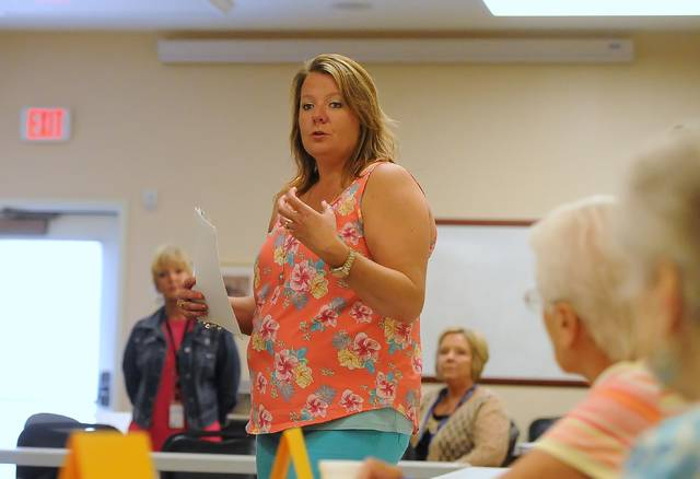 Amber Newcomer, of Greene Respiratory Services, speaks at a recent prevention workshop at Liberty Retirement Home in Lima. Educational health classes are a priority for Area Agency on Aging 3.
