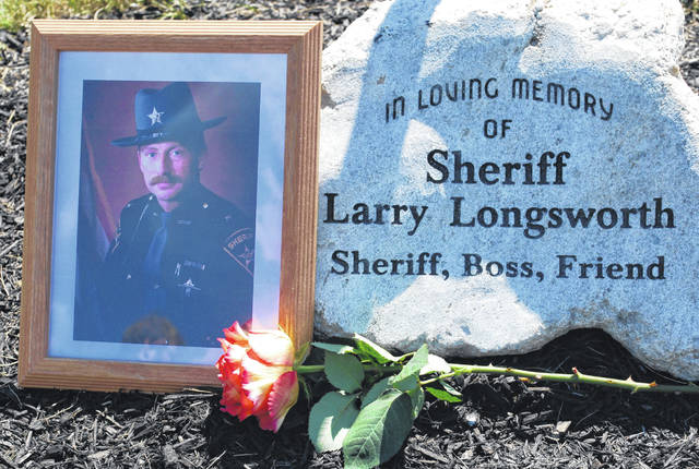 A stone in remembrance of former Auglaize County Sheriff Larry Longsworth was placed beneath a tree planted in his memory during a ceremony Thursday at the Auglaize County Sheriff's Office.