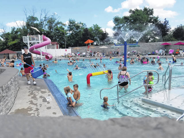 Families packed into the Columbus Grove Municipal Pool, 17510 Road 8P, Columbus Grove, to cool off on July 4. The stone structure opened in 1937 with castle-like turrets. The pool has $1 admission on Wednesdays, and patrons took advantage of it as temperatures hit 90 degrees on Independence Day.
