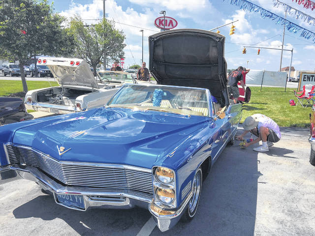 Jaren Law, 18, of Lima, was given this 1967 Cadillace Coupe DeVille convertible.
