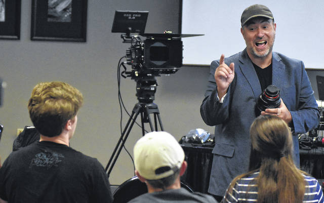 """Aaron Martin, a director with Music and Motion Pictures from San Diego, California instructs young film makers about a camera lens during (SIAFB) Student Integrated Arts and Acting Filmmaker Boot Camp 2018 at Veterans Memorial Civic Center in Lima. Martin is best known for his work as the composer for hits like """"Passion of the Christ,"""" """"Avatar,"""" """"Cars,"""" """"Batman Begins"""" and more."""