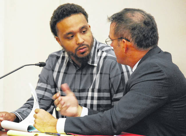 Shay Williams, 29, of Lima, converses with his attorney, Tom Kollin, during a hearing Thursday morning in Allen County Common Pleas Court. Williams is charged as a dealer of drugs in Allen County with five counts of trafficking and/or possession of cocaine filed against him. Two counts would require Williams to forfeit $49,938 if convicted, while another count carries a specification labeling Williams as a Major Drug Offender, a designation that carries a mandatory 11-year prison term in addition to any other sentences handed down.