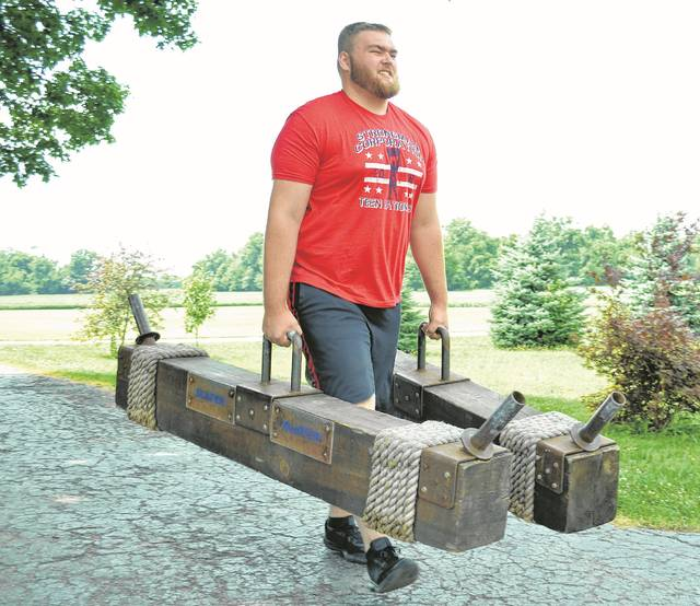Strongman Heavy Weight Teen National Champion Hunter Roethlisberger, 17, of Columbus Grove, performs the farmers walk. He is carrying 135 pounds of weight on each arm.