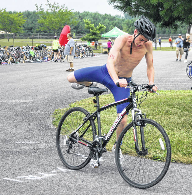 Noah Fisher gets ready to begin the bicycle portion of the Lima YMCA/Kewpee Triathlon/Duathlon held at Ottawa Metro Park Sunday.